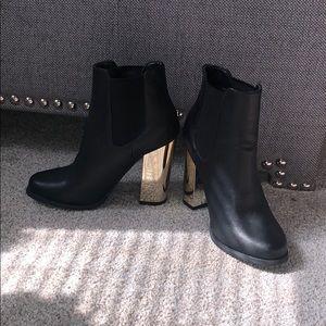 Black bootie with gold shiny block heel